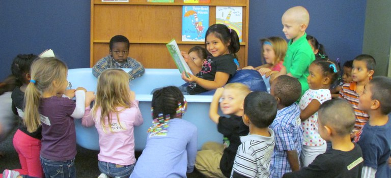 Wilbarger County Preschool student reading to her fellow classmates. May be a young aspiring librarian!